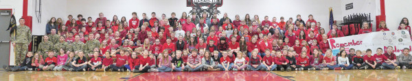 American Legion Auxiliary Unit 100 and the Park City Student Council organized the National Wear Red Day 2019 in Park City last week. A majority of students and staff wore red to remember everyone who is deployed in the military, then gathered for a photo in the gymnasium. Outlook photo by Chris McConnell