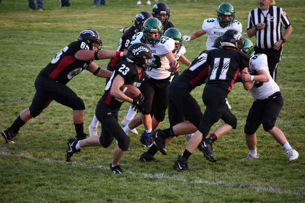 Park City Junior Stockton Zimdars looks for a hole while a gang of blockers push back the offensive line during the Panthers' 44–20 home win over Ennis on Friday night. Photo courtesy Randi Dennis