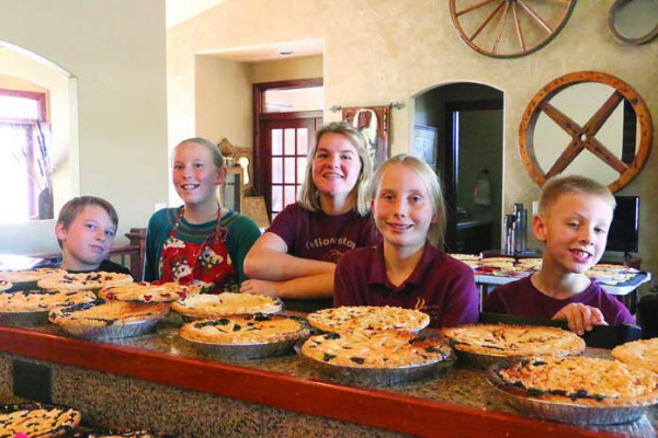 Gibson Waite, Elsa Waite, Ava McKeever, Oriane Hurtig and Caleb Tober show off some of the 76 pies they made with the help of Yellowstone Silver Spurs 4-H clubmates Kelsey Beck, Rachel Hamilton, Lea Bickle, Austin Shinn, Dakotah Shinn and Madeline Felder last weekend. The pies were frozen after a productive day of baking and delivered to Community Hope for inclusion in holiday food boxes and for dessert at the annual community Thanksgiving Festival of Praise.