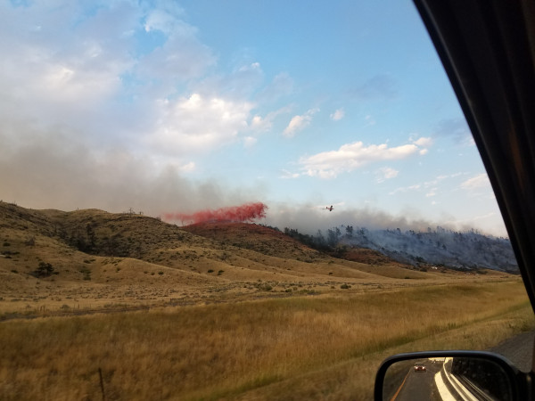 Photos courtesy of Gene Gilluly. Laurel firefighters were among the many working to put out the Beartooth Vista Fire near Columbus Saturday evening. Joining in the fight were aircraft which dropped fire retardant on the fire near Interstate 90.