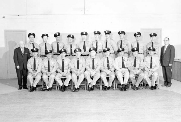 Laurel Auxiliary Police shown in their first formal picture, posed with Mayor Parker and Mayor-elect Beslanwitch. The 21 men have been selected and trained to provide emergency service in Laurel and to augment the regular police force. Members of the force, under Chief Harold Collins, are W.L. Thurn, L.W. Armstrong, Robert Barnhardt, Charles Butkay, Carl Koski, Fred Vogel, W.T. Nelson, Harry Hodges, Roy Horning, Robert Fry, Phillip Morrow, Samuel Mourich, John Stevens, R.H. Strending, T.A. Bennett, Cary Ols
