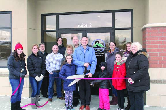 Chiropractic First of Laurel held their ribbon cutting last week at their new location with Laurel Chamber of Commerce members. Adults from left are Beth Hoferer, Katie Whitmoyer, Bruce Larson, Brian Bushman, Chase Anderson, Sandy Mohr, Doug Nebeker, Dr. Eric Belnap, Andrea Belnap, Camilla Nelson and Marcia Hafner. The children are Olive Belnap, Otto Belnap and Eva Belnap.