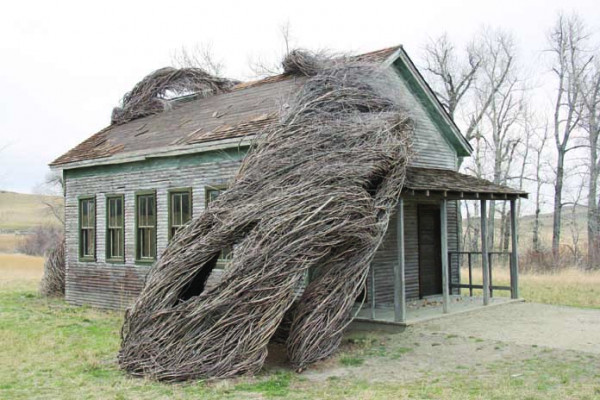 "Freddy Krueger's scary Elm Street house has nothing on the ""Daydreams"" school house at Tippet Rise Art Center outside Fishtail. Internationally acclaimed environmental sculptor, Patrick Dougherty, was commissioned to build the piece in 2016. It is located a short walk from the Olivier Music Barn at Tippet Rise."
