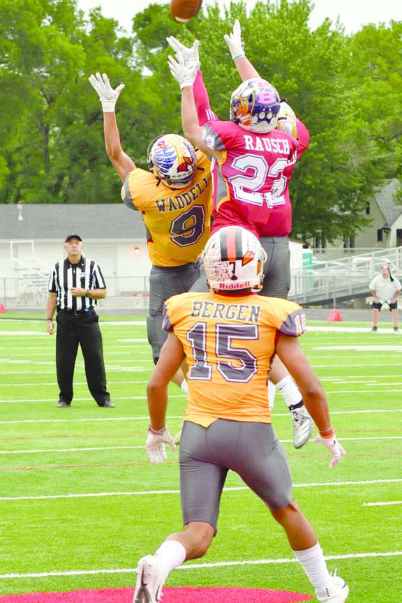 Jack Waddell (#9) goes up for a pass during the East–West Shrine game last week. The West All– Star team won the game 21–12.
