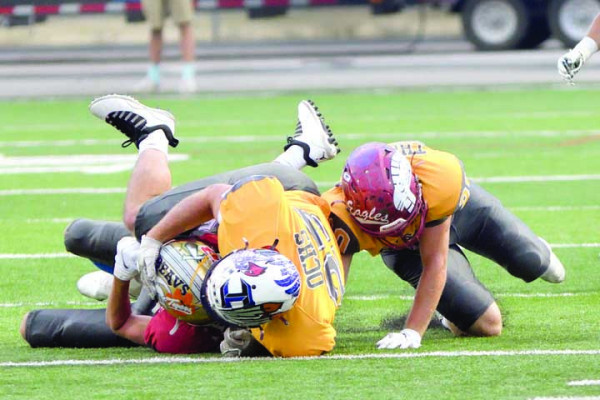 James Ochs tackles a player at the East–West Shrine game last weekend in Billings.