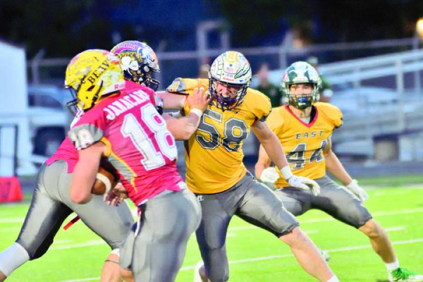 Colter Bales (#58) fights off an offensive lineman last weekend.