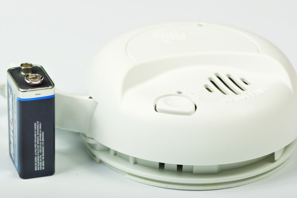 Inspect and clean smoke alarms monthly and replace batteries in the spring and fall.