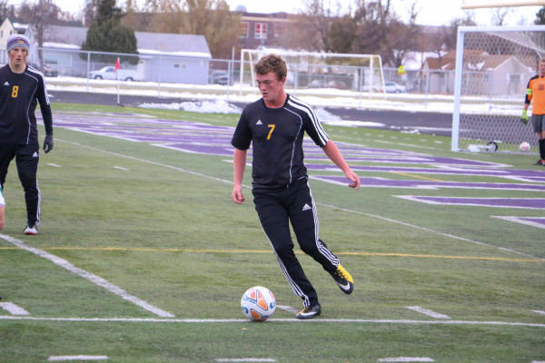 Outlook photo by Connor Waddingham                        Laurel senior Ricky Temporal dribbling the ball in the State championship game against Whitefish.