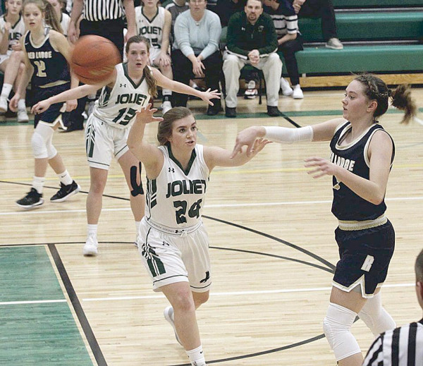 Photo courtesy of Hank Nowak                        #24 Brooke Miller attempts to intercept a pass; #13 Shayla Webber posts up close by.