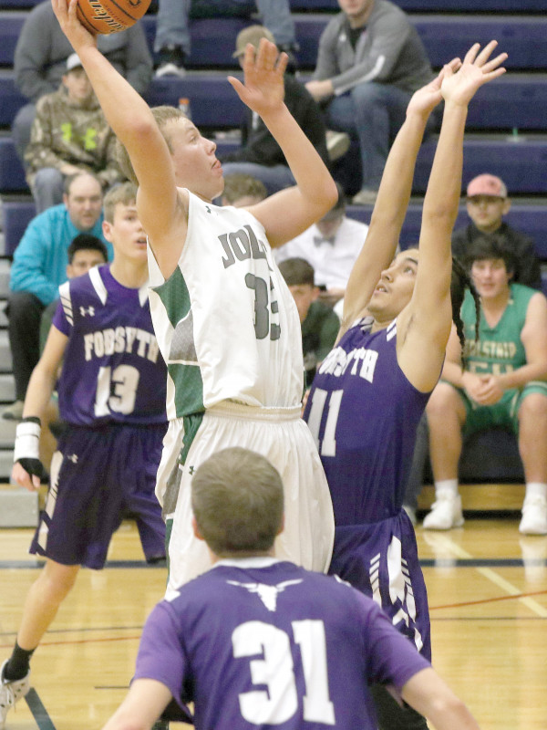 Photo courtesy of Lynn Kramer                        Kelly Lind (#33) of Joliet goes up for a hook shot in the paint against the Forsyth Dogies. Joliet just snuck out this victory, winning 35-31.