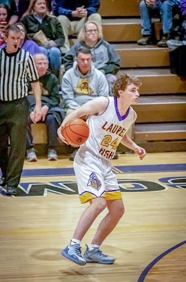 Photo courtesy of Kathleen Linger                        Laurel senior Gus Crowl dribbles behind the arc on Senior Night. This was Gus' final home game and he went on to grab two rebounds and dish out an assist.