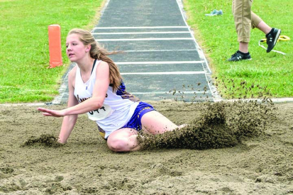 Photo courtesy of Gloria Allwin                        Sophomore Gracey Willis landing in the sand pit after one of her long jump tries at state. She wound up placing third in the long jump for Class A girls, and also set her PR in the event with a leap of 17-02.25 feet.