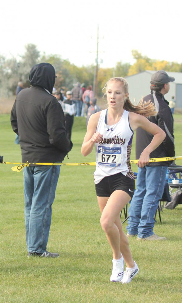 Photo courtesy of Pam Trostle                        Grace Timm running in the Custer County Invitational on Oct. 5. She took second overall with her time of 19:22.
