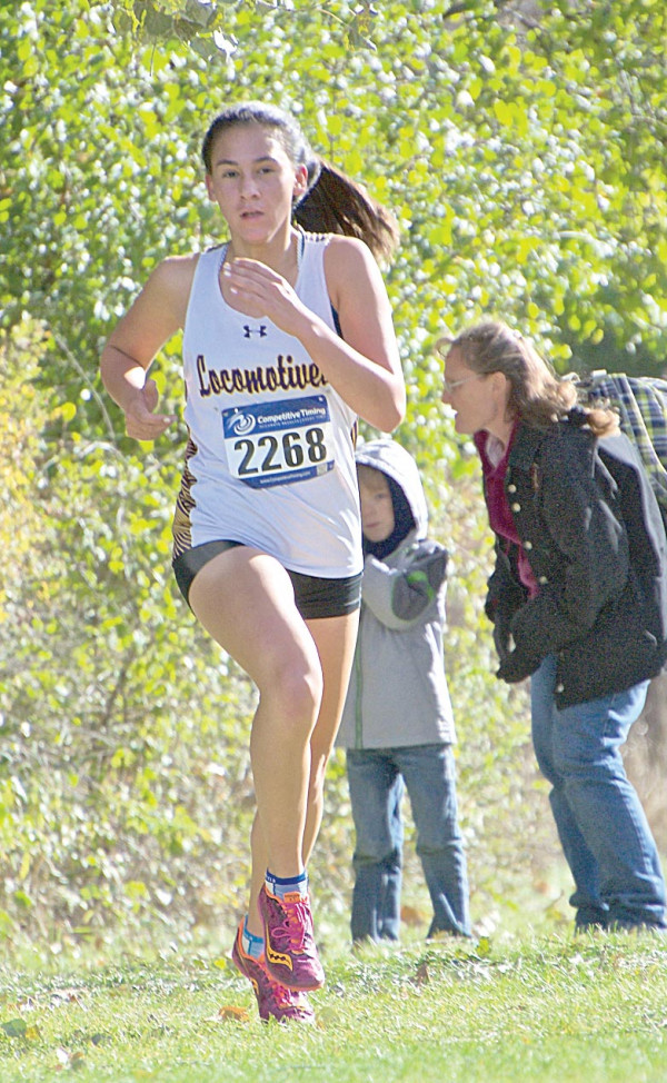 Photo courtesy of Gloria Allwin                        Junior Andria Mourich pushing hard toward the end of the Eastern A Classic on Saturday. Mourich turned heads in this meet as she took first place overall and shattered her previous PR.