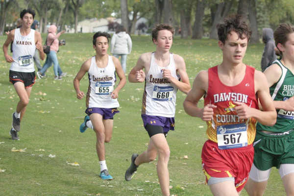 Photo courtesy of Pam Trostle                        Ivan Lee (#655) and Dylan Paris (#660) running closely to each other in the Custer County Invitational meet. The Class A Cross Country Divisional meet is this Saturday, at Billings Central.