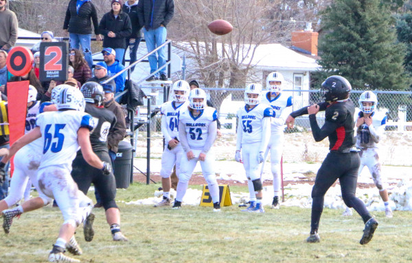 Outlook photos by Connor Waddingham                        Quarterback Carson Baker throwing a pass in the Panthers' playoff game against the Mission Bulldogs.