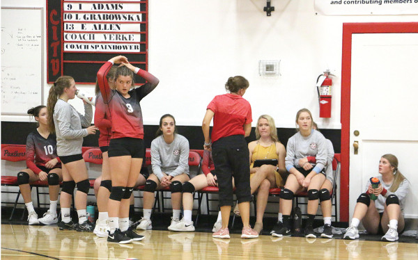 Outlook photo by Connor Waddingham                        The Lady Panthers volleyball team sits on the bench before their homecoming matchup with the Plenty Coups Lady Warriors.
