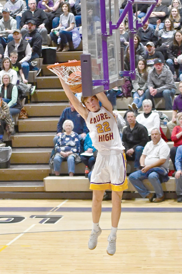 Senior Levi Taylor dunks the ball during a game against Hardin at LHS in January.