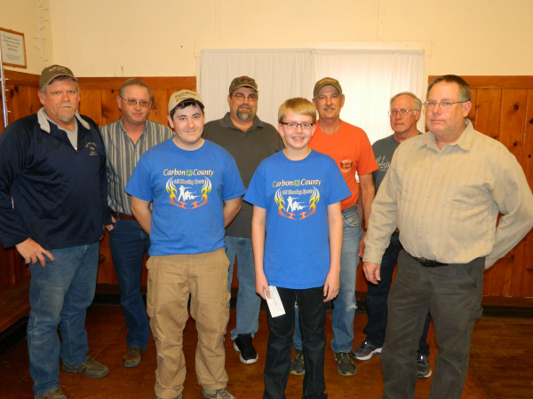 Members of the Tri-County Sportsman's group give the Carbon County 4-H Shooting Sports youth a check for $3,126. Shown are 4-H members, their coaches and Tri-County Sportsmen Mike Connoly, Kent Miller, Jim Simons, Stu Korth and Curt Lord.