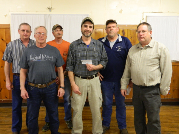 Members of the Tri-County Sportsman's Group give a check to Howard Rickard of the Jaycees. The Jaycees let the Sportsman's Group and the youth groups they sponsor use the Jaycee building in Riverside Park for meets, training and hunters' safety.