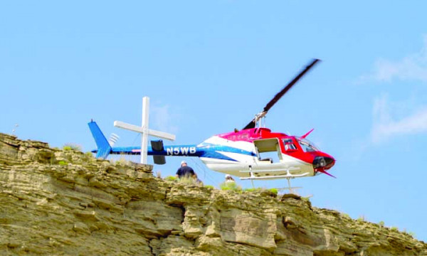 In September, a helicopter carried volunteers and a new solar lighting system to the top of Square Butte. The volunteers installed the new system which shines brightly on the cross originally installed in 1953.