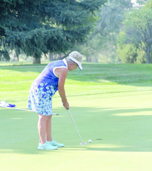 Laurel's Sue Matson rolls in a par putt on 16 to maintain a three-shot lead with two holes to play in the Montana State Senior Women's Amateur at Laurel Golf Club on Saturday. Matson won the tournament by four shots to claim an unprecedented fourth title.