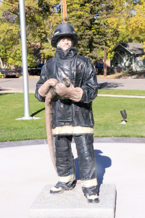 Outlook photo by Kathleen Gilluly. This statue of a firefighter sits in the center of the park which is being transformed  into the Montana State Firefighters Memorial with the help of volunteers and donations from local businesses.