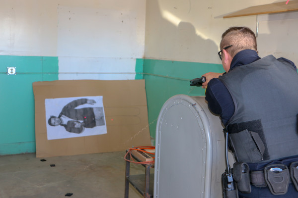 Officer Fred Gregory practices using the X2 during a training session for all Laurel police officers last Wednesday. Note the laser sight allows Officer Gregory to stun a suspect who may be rolling under a car or trying to evade the police.