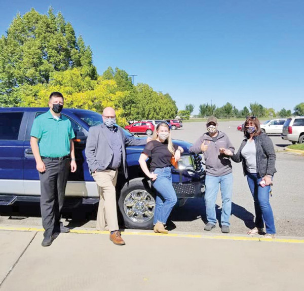 Staff from Valley Credit Union present Jeff Ewalt, executive director of ZooMontana with a truck to replace one stolen and recovered damaged beyond repair. Courtesy photo