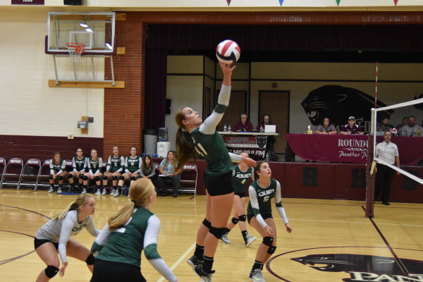 Courtesy photo. Tayler Wright goes up for the kill in a game against Roundup last Thursday. The J-Hawks won the match in five games.