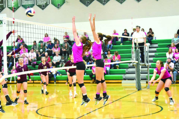 Courtesy photo. Shayla Webber (left) and Makenna Bushman are shown blocking against Roundup. Joliet defeated Roundup in three games and are the #2 seed at the District 4C tournament tomorrow in Huntley.