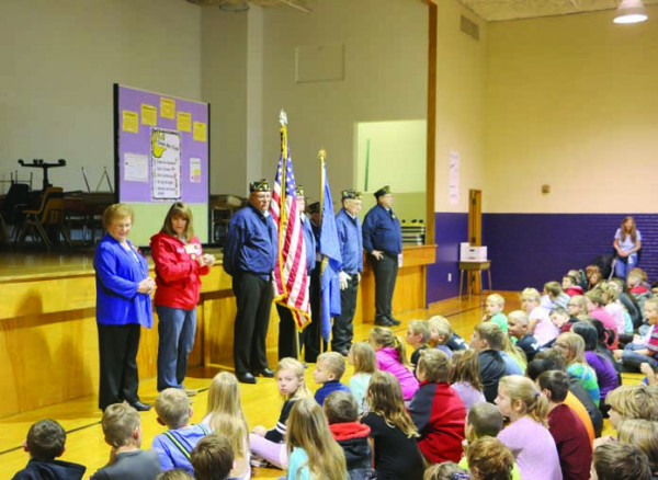 Although it wasn't officially Veterans Day, the third and fourth-grade students at Graff Elementary School took time to meet some veterans during an assembly Thursday, Nov. 9. They enjoyed a short program with a color guard presented by Laurel's American Legion Post #123. The program also included a short speech about the flag and the meaning of the poppies by Roxanne Roberts, the American Legion Auxiliary Secretary/Treasurer.  Ken Gomer, American Legion Post Commander talked about his experiences in the Na