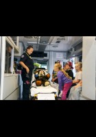 An emergency services volunteer shows children with the help of a Teddy bear the different lifesaving components inside an ambulance during the Laurel Volunteer Fire and Ambulance Department's open house last week.
