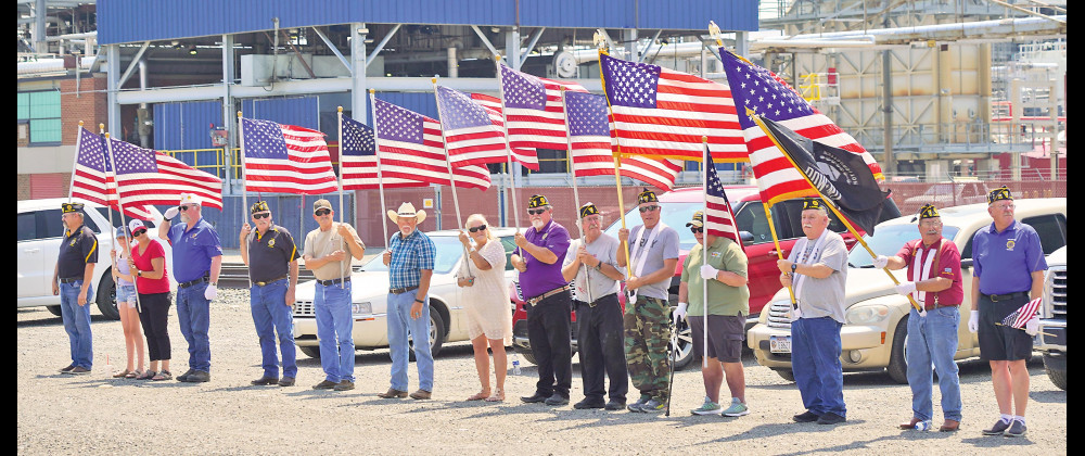 Members of the Laurel American Legion Post #123 lined up by the CHS refinery on Monday to pay respects to fallen Airman Alva Ray Krogman whose remains were recovered in Laos more than 50 years after he was shot down during the Vietnam war in 1967. The procession started at the Billings airport and traveled through Laurel en route to Krogman's final resting place in Worland, Wyo. Outlook photo by Chris McConnell