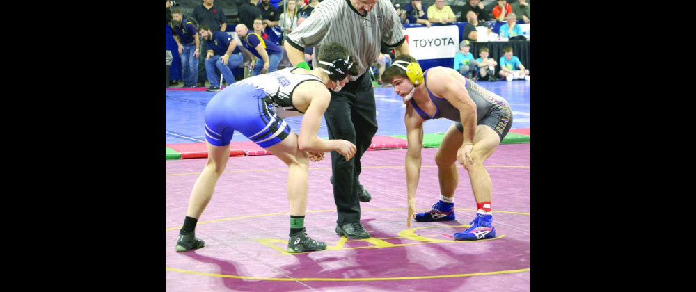 Photos by Jackson McMurrey Locomotive Cameron Younger, wrestling for the 182 weight class, surveys his opponent that he will soon take down.