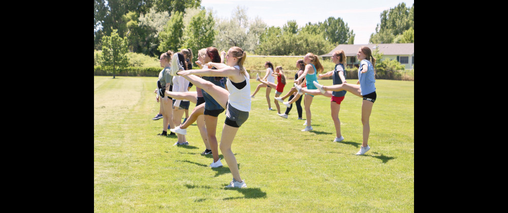 Soon-to-be Laurel High School cheerleaders run a routine drill in the field of Murray Park during tryouts on June 2.