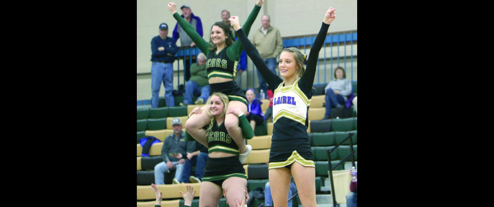 Photo by Jackson McMurrey Laurel cheerleader, Audrie Jensen, is lifted for a stunt while RMC cheerleaders do a similar maneuver behind her.