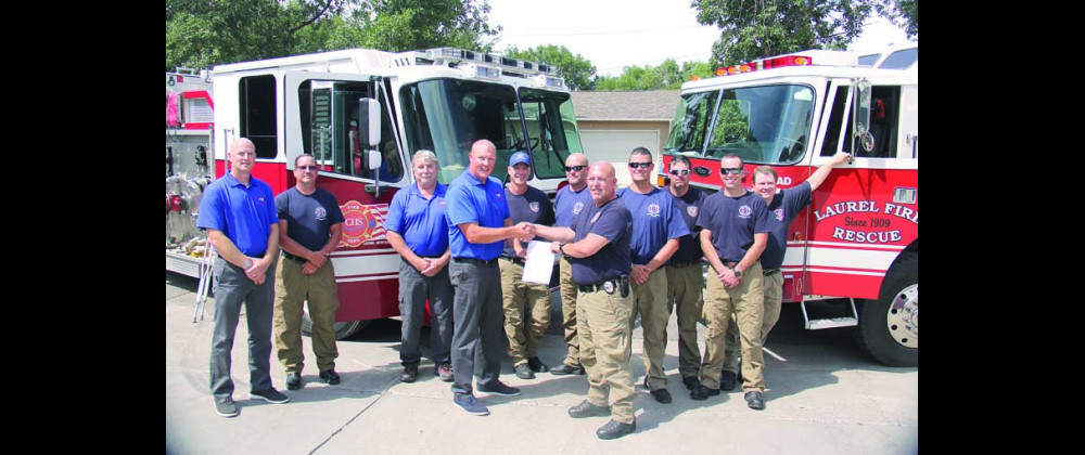 """In August, CHS fire and safety personnel present a $50,000 donation check to the Laurel Volunteer Fire Department to purchase new """"jaws of life"""" extrication tools."""