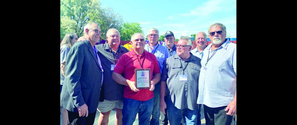 Photos courtesy of Ryan Mayes                        Members from the Laurel Locomotives Big 32 State Championship team of 1968-69, with one member holding the Hall of Fame induction plaque.