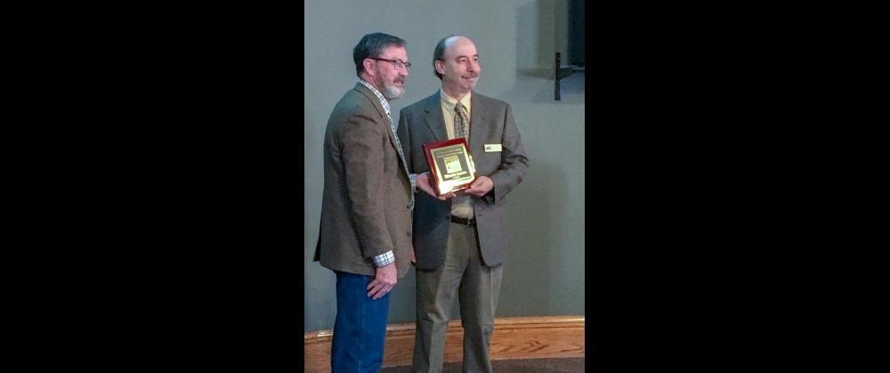 """Ed Saunders of Laurel was honored Tuesday at the 2019 Yellowstone County Historic Preservation Board's Roundtable at the Western Heritage Center. He received the Eugene Carroll Historic Preservation Award, awarded to an individual or organization for work in historic preservation. Saunders has worked to elevate the role of Montana's women in World War 1 through his research and publication of """"Knapsacks and Roses,"""" available at Amazon."""