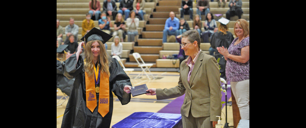 Sydney Bakich adjusts her mortar board as she receives her diploma from Laurel School District Superintendent Dr. Linda Filpula while LHS Principal Shawnda Zahara watches.