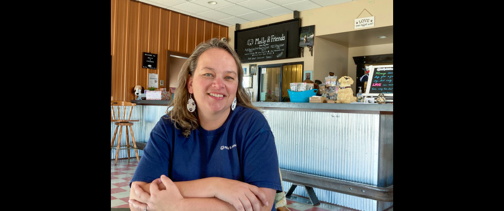 Jodi Mackay is a life-long dog lover who runs her doggie day care with help from office manager Paige Farmer.