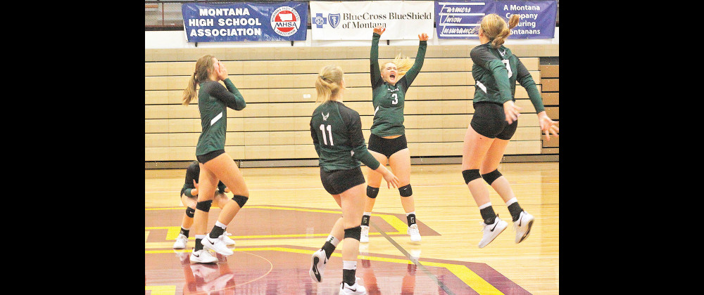 The Lady J–Hawk volleyball team celebrates after they scored their final point to secure Joliet's first ever State title. The girls defeated Huntley Project in straight sets in Shelby to win the Class B State Championship on Nov. 14. Photos courtesy Hank Nowak
