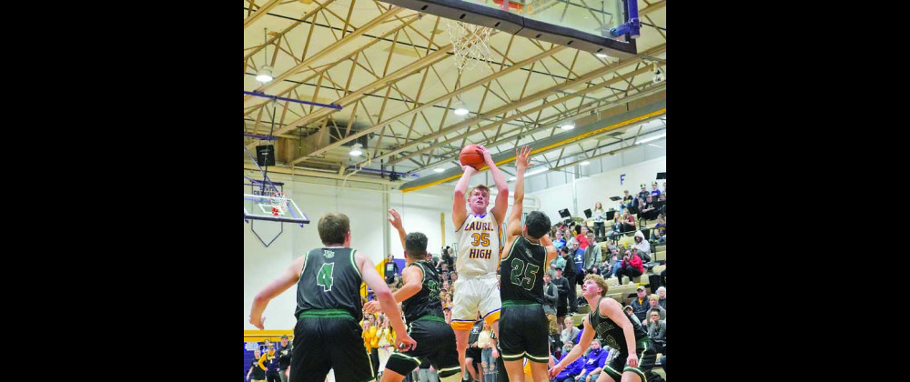Laurel Senior Colter Bales takes a pull–up jumper in the first half of the Laurel/Billings Central game last Thursday. Bales made a monster 3–point play with nine seconds left in the game to seal the 42–40 Loco victory. Laurel is the #1 seed in the Divisional tournament at MetraPark in Billings, which started yesterday. Outlook photo by Chris McConnell