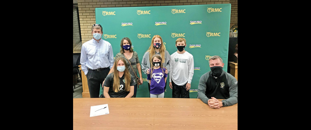 Morgan Maack (front left) with her family and future coach last week after she was awarded an athletic scholarship to play soccer for Rocky Mountain College. In the back row are Tom, Kami, Mya, Maizy (purple) and Luke. Front right is RMC Women's Soccer Coach Richard Duffy. Courtesy photos