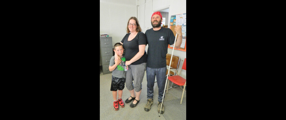 Mike's son Tate and his girlfriend Kimberley Johnson with Mooney at the Outlook on Tuesday. Johnson is also a member of the Montana Association for the Blind. Outlook photo by Kathleen Gilluly