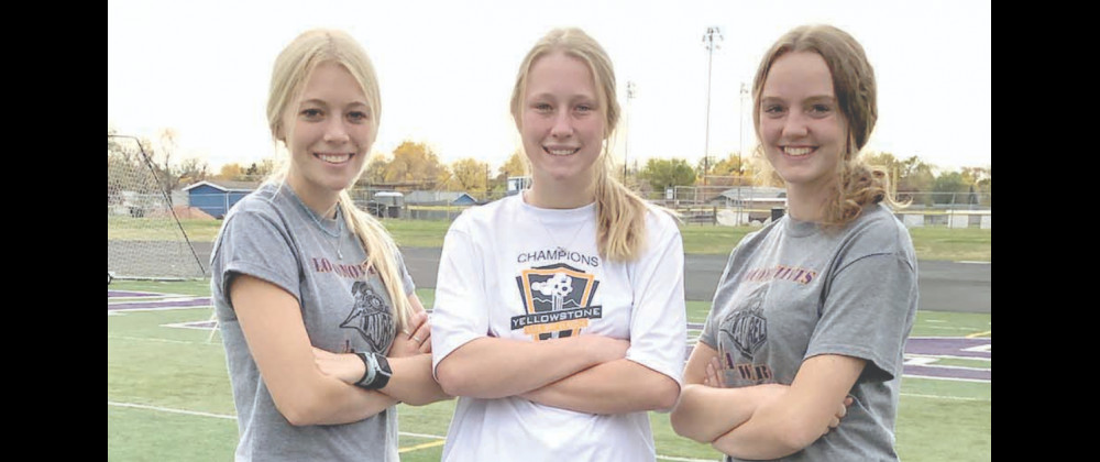 (Left to right): Senior captains Chloe Baumann, Anna Cole and Grace Wagner helped the younger players learn about Laurel's legacy in girls soccer this season.