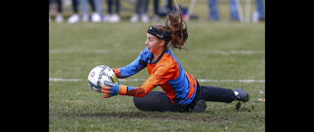 Photo courtesy of Bethany Baker, Billings Gazette                        Freshman phenom goalkeeper Mya Hansen making one of her many saves in the state championship against Billings Central on Saturday.
