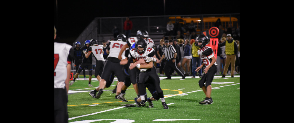 Holden Stepper tries to shake a tackler during the Panthers' 52–14 win against Lone Peak last Friday. Photo Courtesy Randi Dennis