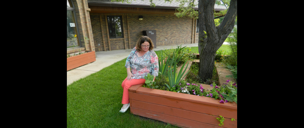 Laurel Library Director Nancy Schmidt talks about the value of the outside flower boxes to library patrons. The boxes offer a quiet spot for reading or reflection and attract bees and other pollinators.